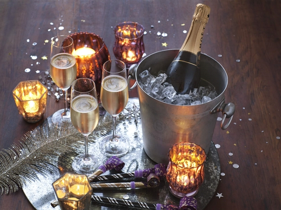 Champagne on ice with candles